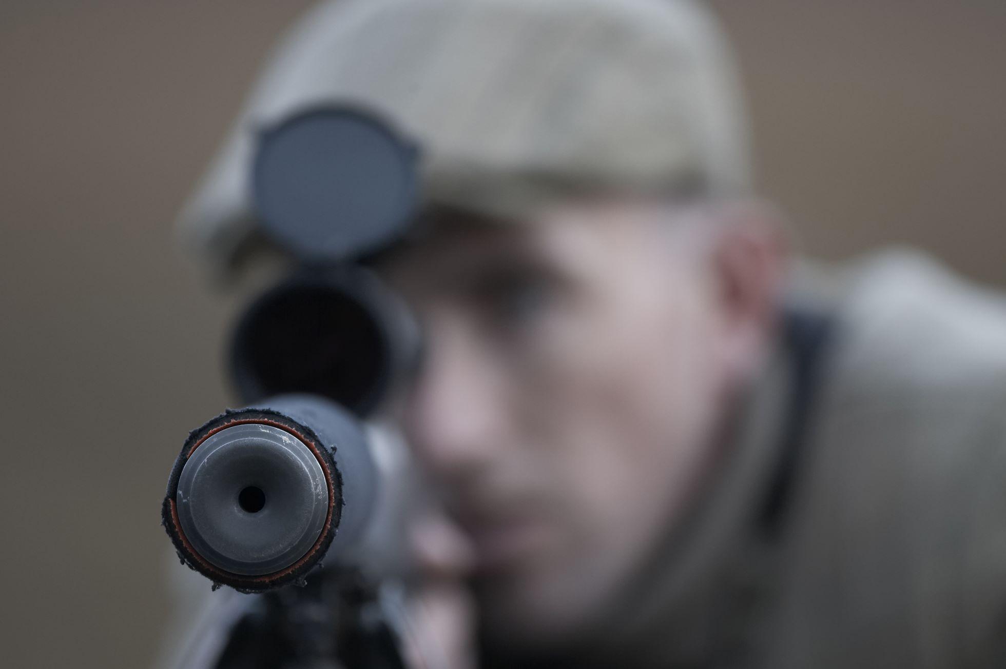 Close up of deer stalker and rifle, Alladale Wilderness Reserve, Sutherland, Scotland.