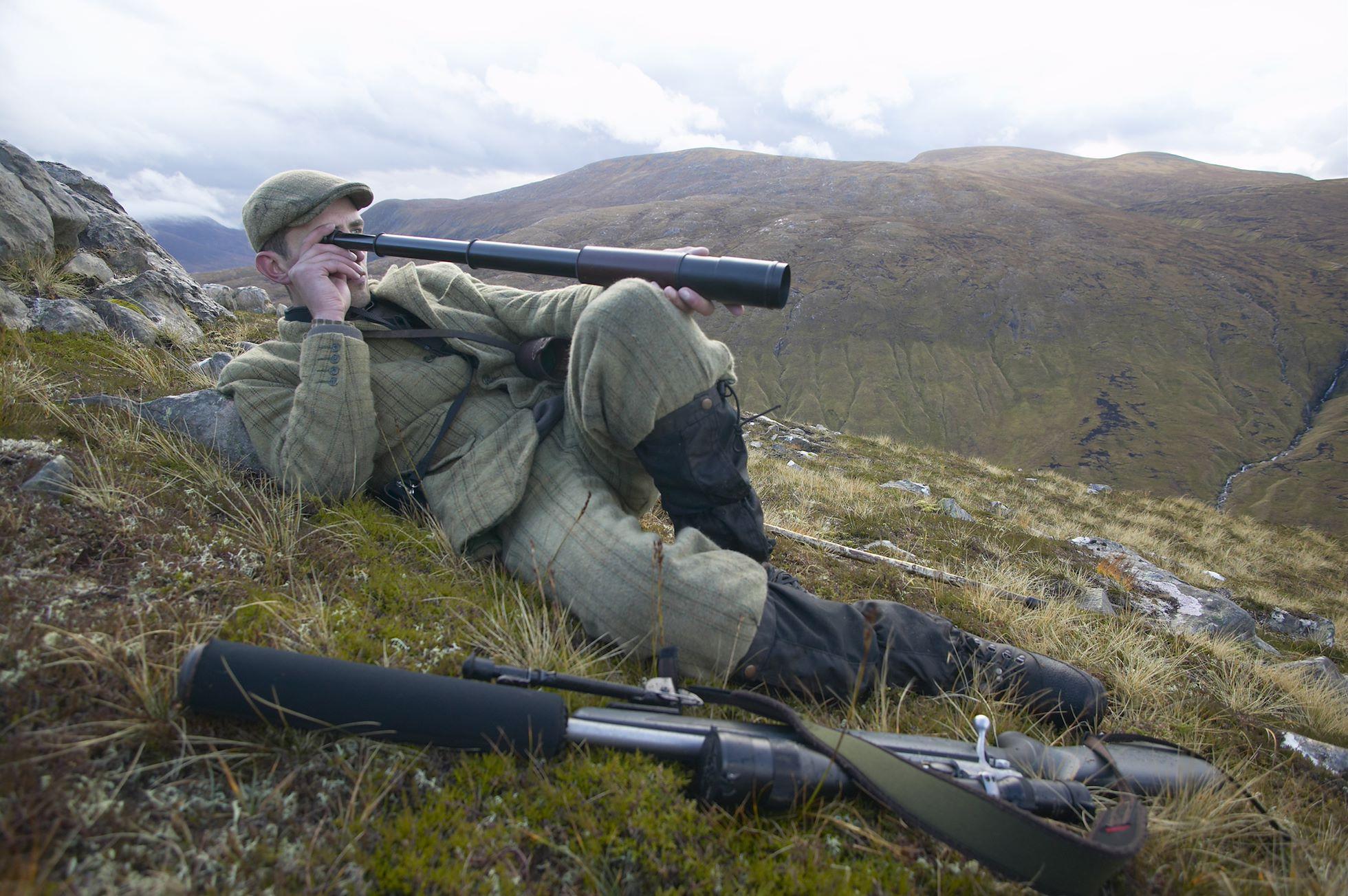 Innes MacNeill, head ranger, Alladale Wilderness Reserve looking out over Glen More during October hind stalking, Alladale, Scotland.