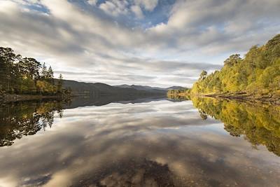 Autumn reflections over Loch Beinn a Mheadhain, Glen Affric, Scotland.