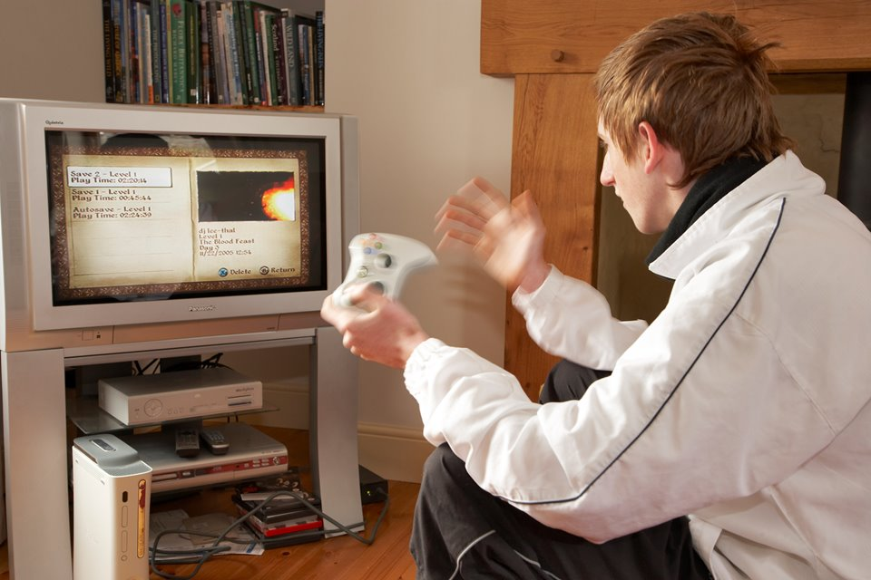 15 year old boy playing computer game. UK. April 2007.